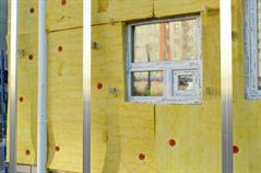 Picture of a house in its building process, insulation is in focus.