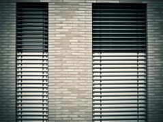 Picture of ouside sunblinds at a building.